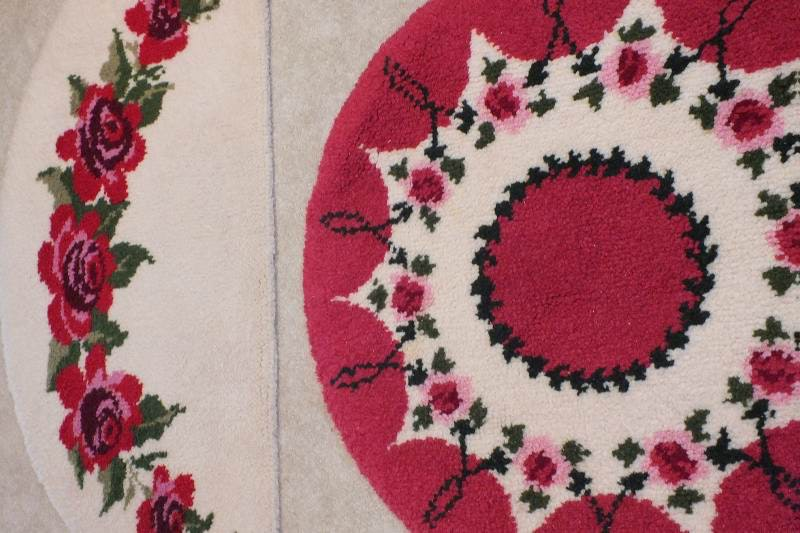 a pair of shillcraft area rugs hand woven by artist in pretty hot pink