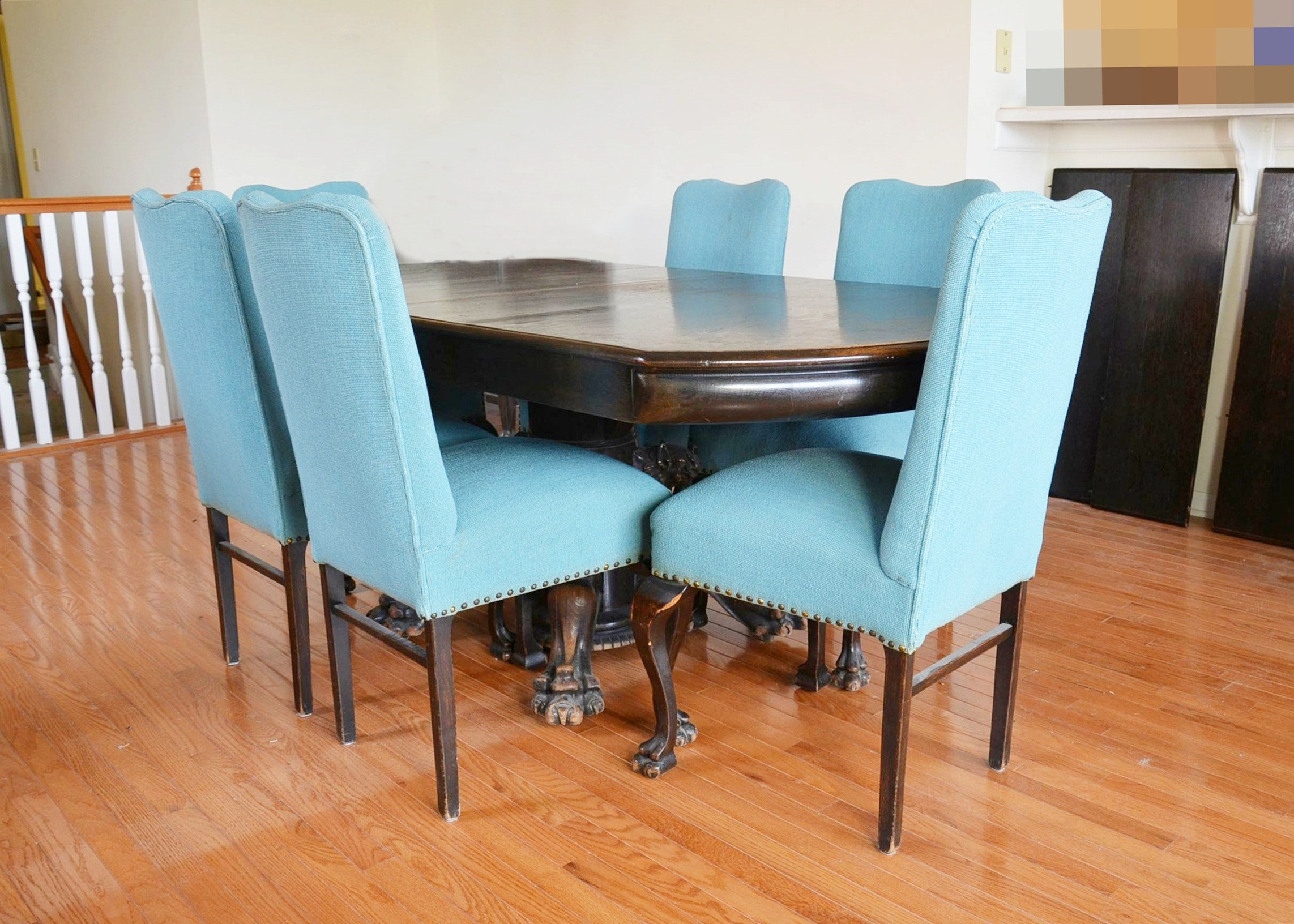 Renaissance style dining room table with eight upholstered chairs.