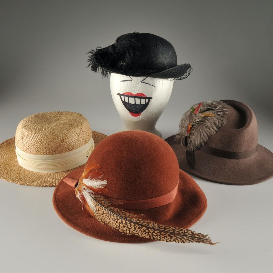 Four vintage hats including a Georgi black stylish cellophane hat with  ostrich feather   EBTH ed597092565