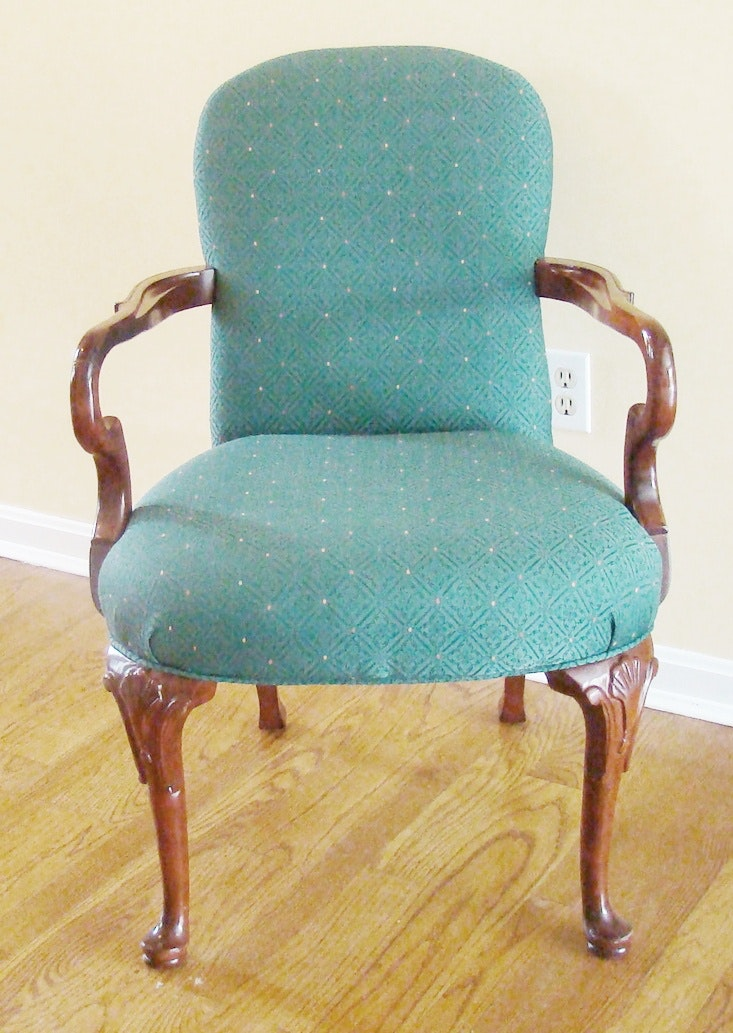 Cushioned Louis Style Arm Chair With Carved Details.
