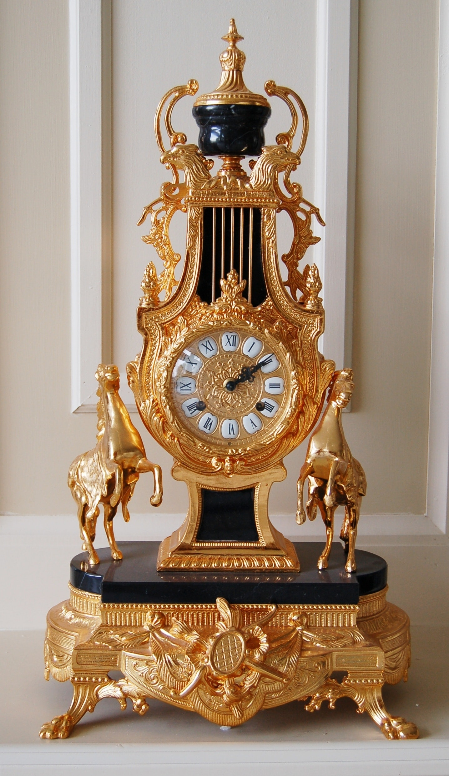 Empire Style Black Marble and Gilt Mantel Clock