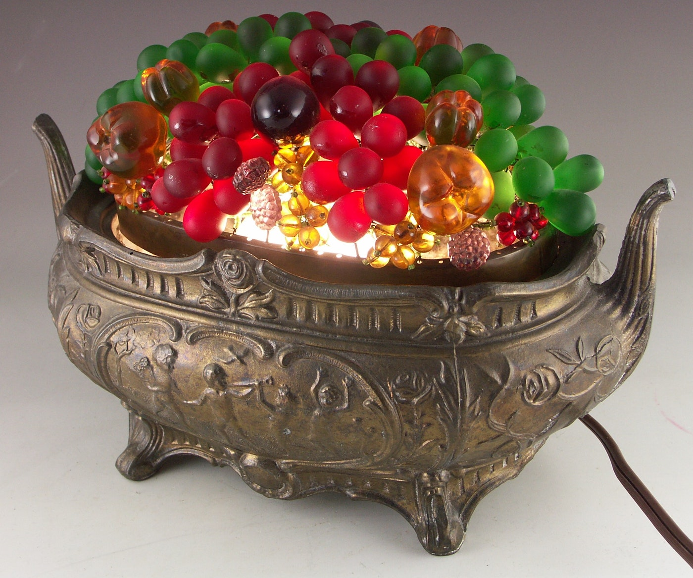 Vintage cast metal bowl with lighted glass and beaded