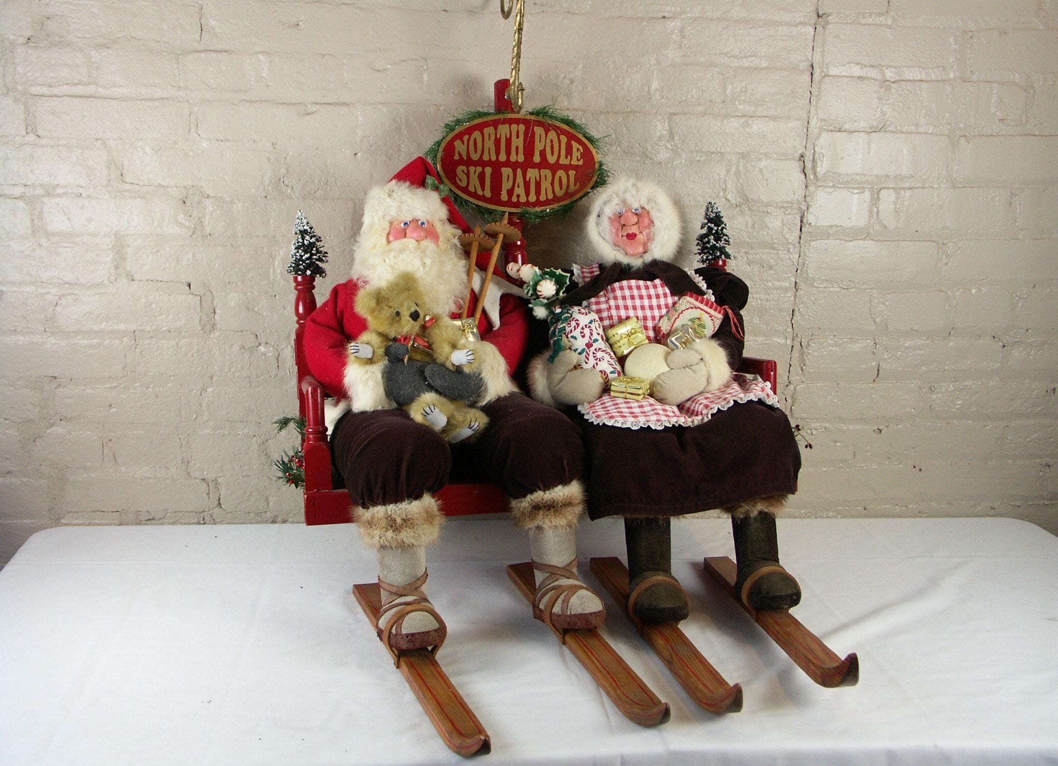 "Original Brian Kidwell ""The Toymaker"" Santa and Mrs. Claus Ski Patrol Sculpture"