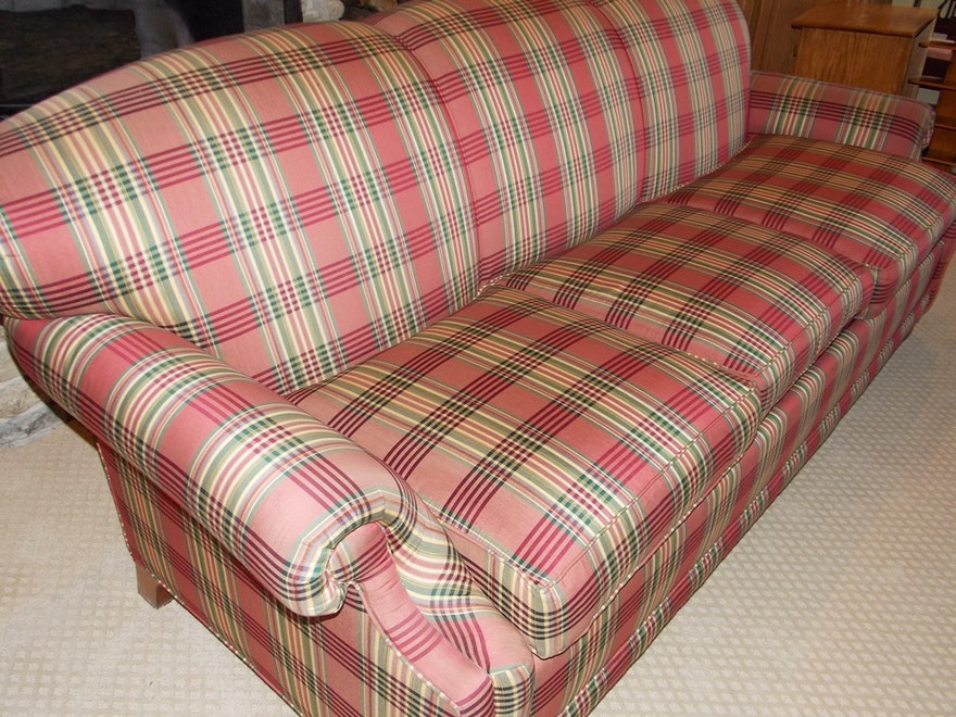 A Plush Sofa In A Soft Red Beige And Sage Green Plaid Ebth