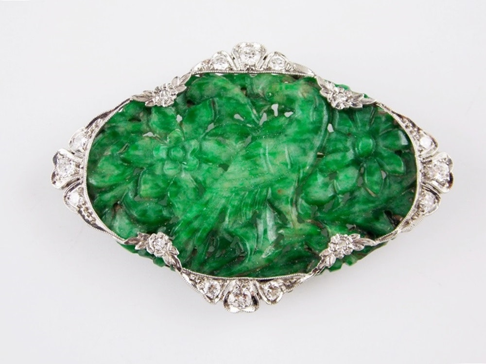 An Exquisite Art Deco Carved Jadeite Pin in a Platinum and Diamond Setting