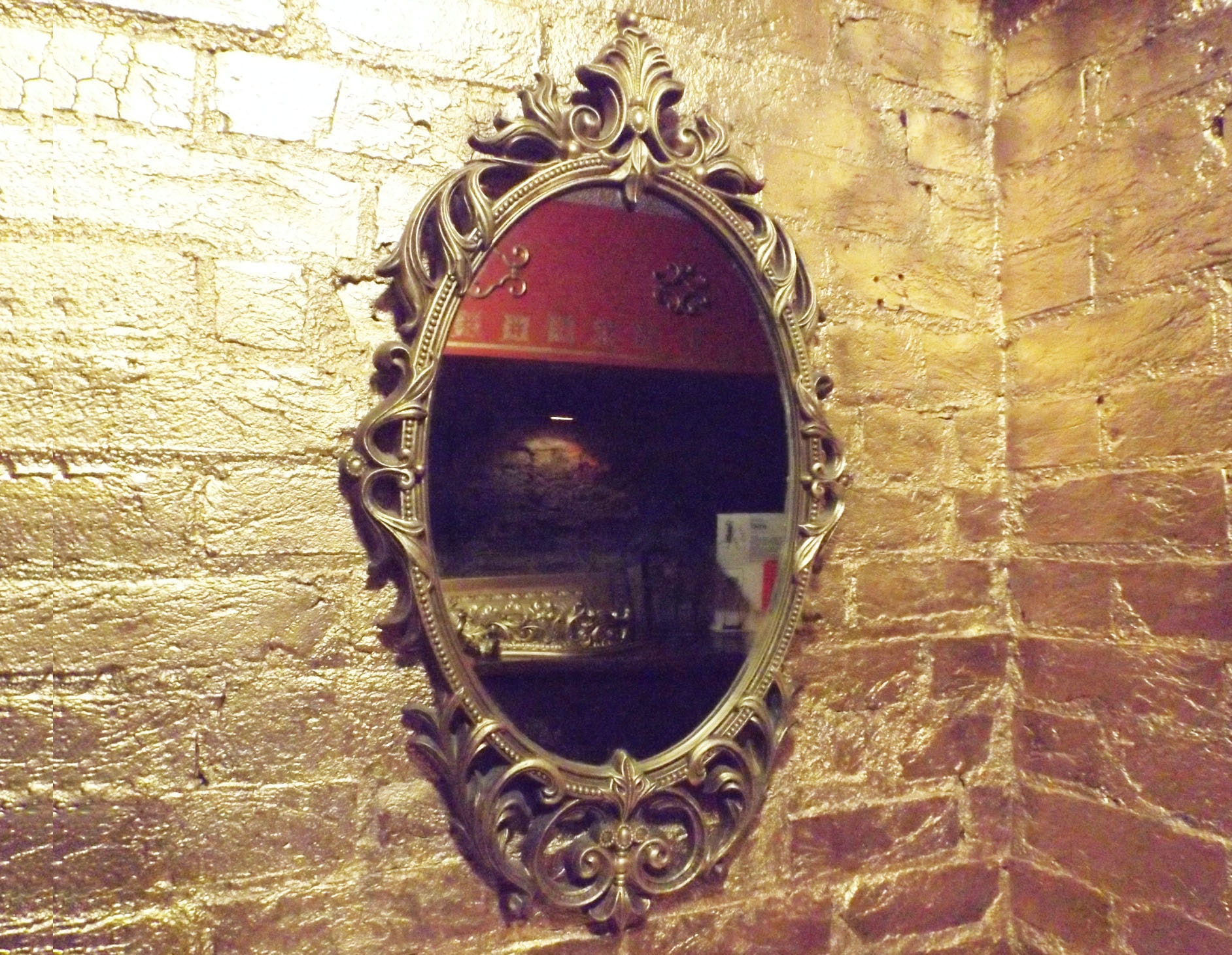 Ornate Gilt-Framed Mirror