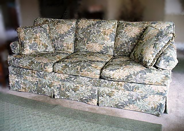 A Triple Cushion Sofa, Overstuffed, Floral Design In Shades Of Pale Sage  Green