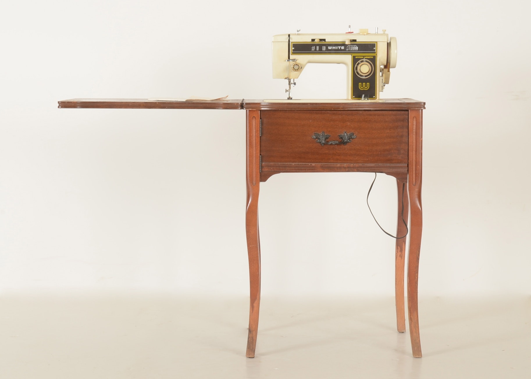 white sewing machine table