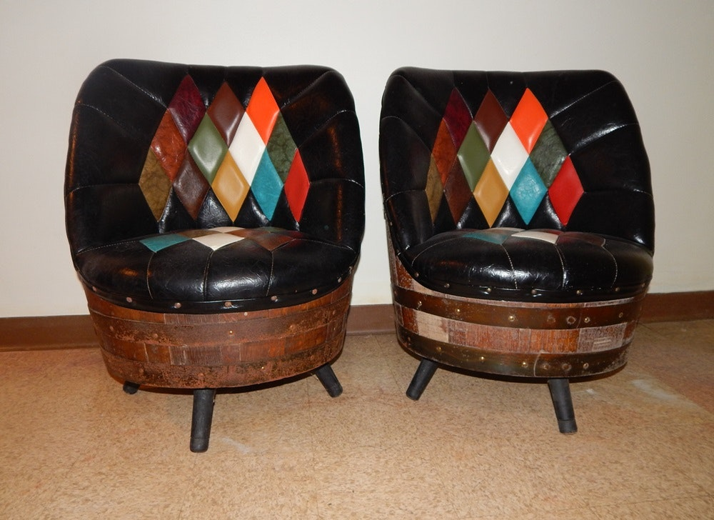 pair of whiskey barrel and leatherlook chairs