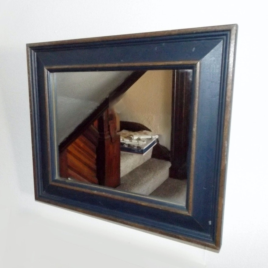 A Navy Blue Framed Mirror