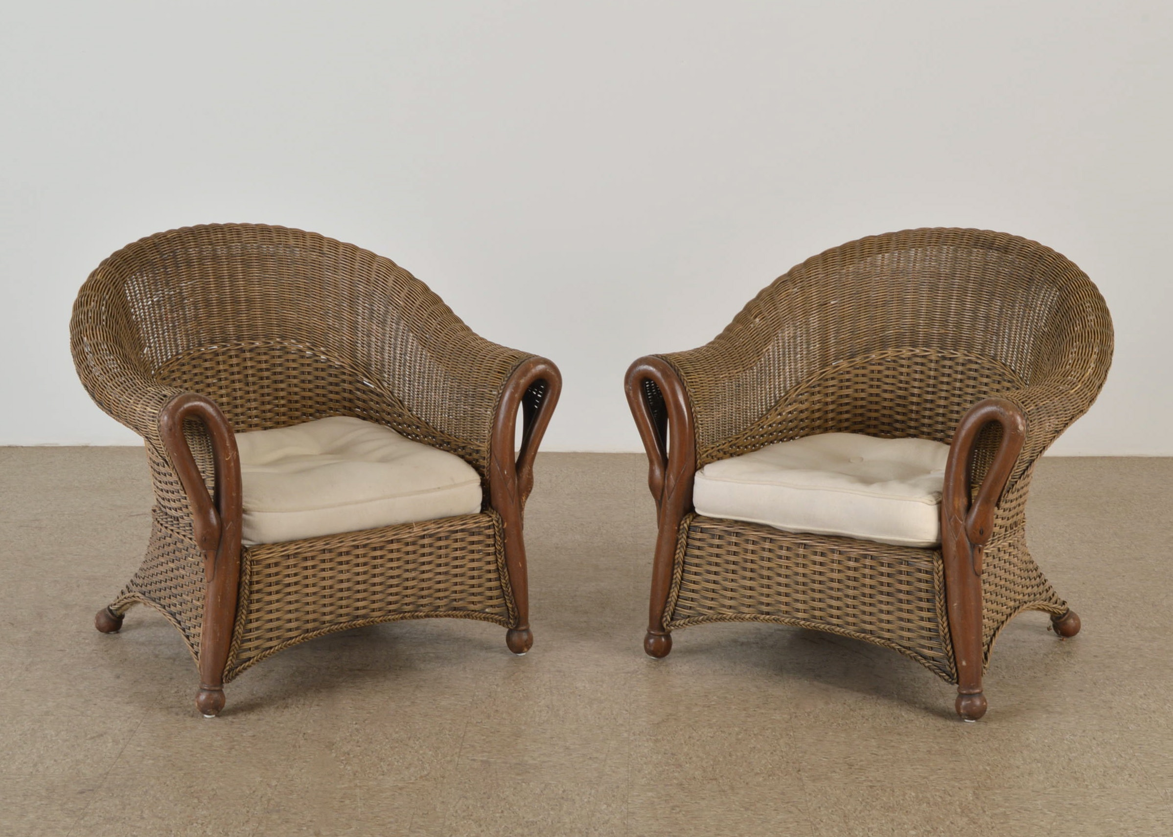 pair of swan neck wicker chairs