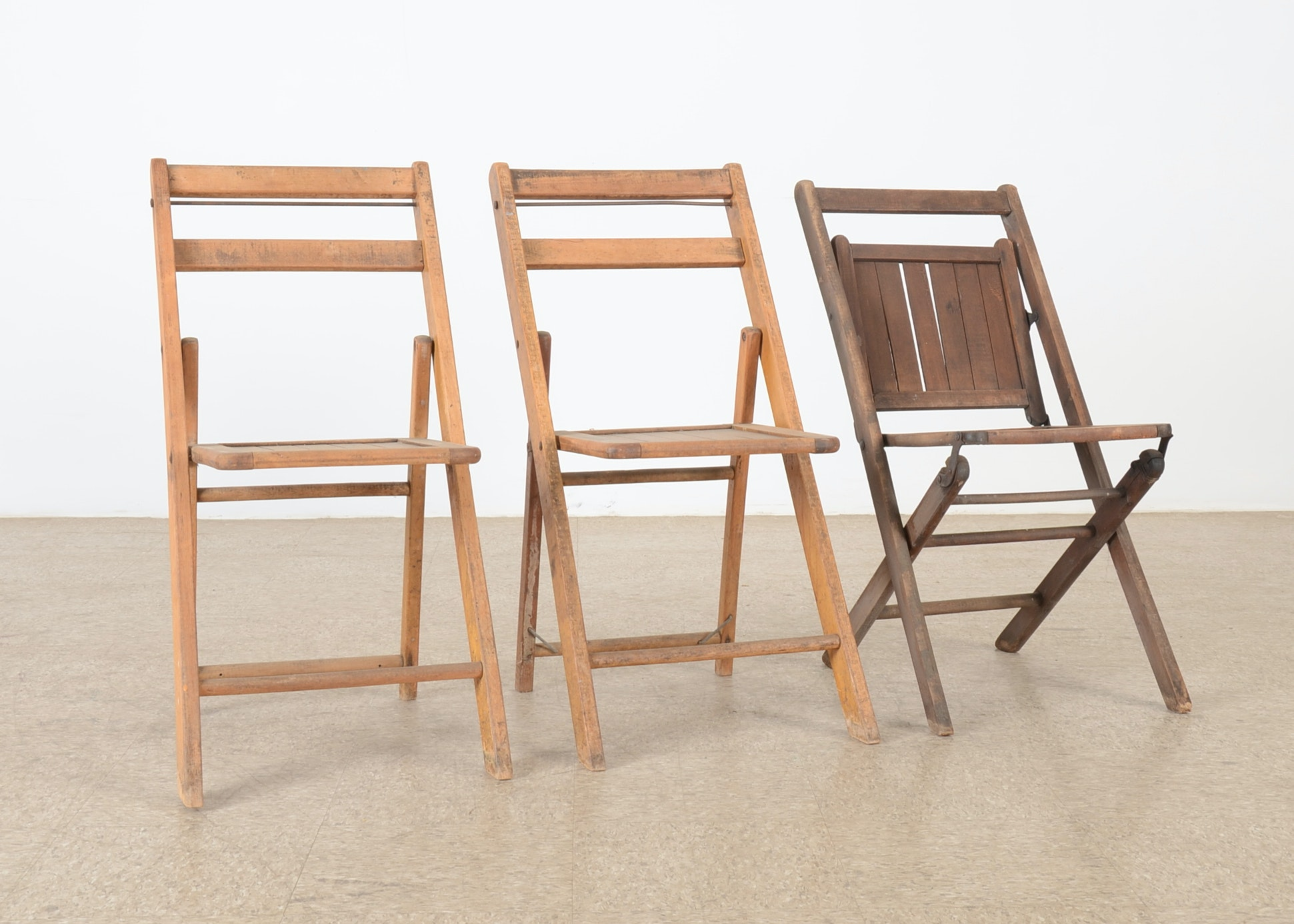 A Set Of Three Antique Wooden Folding Chairs