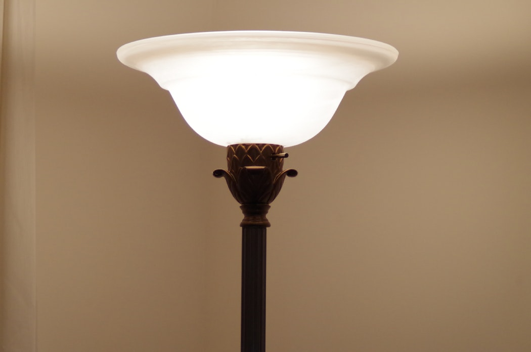 torchiere lamp with cream frosted glass shade and brass base