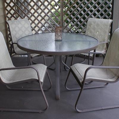 metal and glass patio set