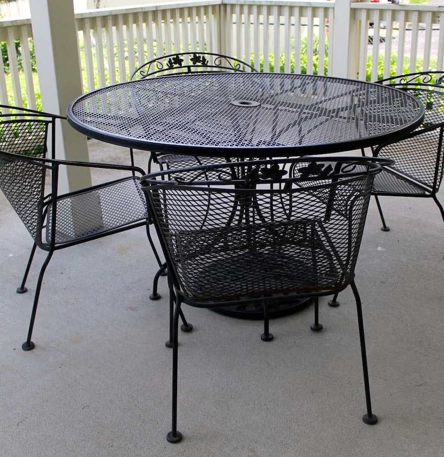 Wrought iron patio table four chairs and umbrella stand for Outside table and chairs