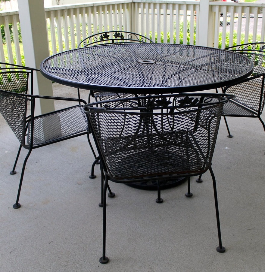 Wrought iron patio table four chairs and umbrella stand for Patio table and umbrella sets