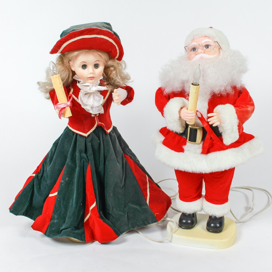 pair of animated christmas dolls holding illuminated candles - Animated Christmas Dolls