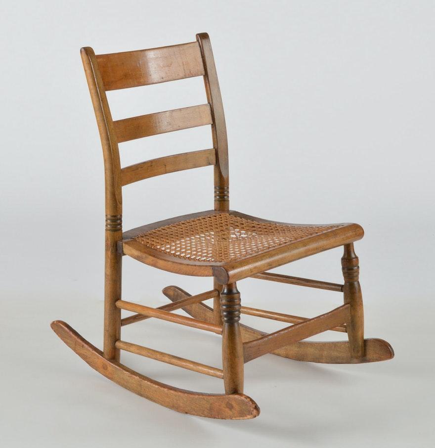 antique oak cane seat low rocking chair ebth. Black Bedroom Furniture Sets. Home Design Ideas