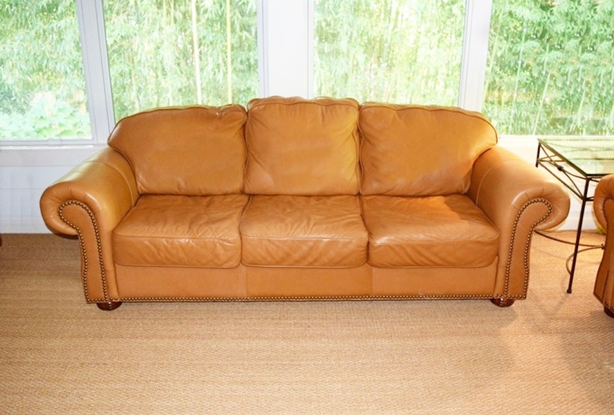 A Buttery Soft Leather Sofa With Nail Head Trim ...