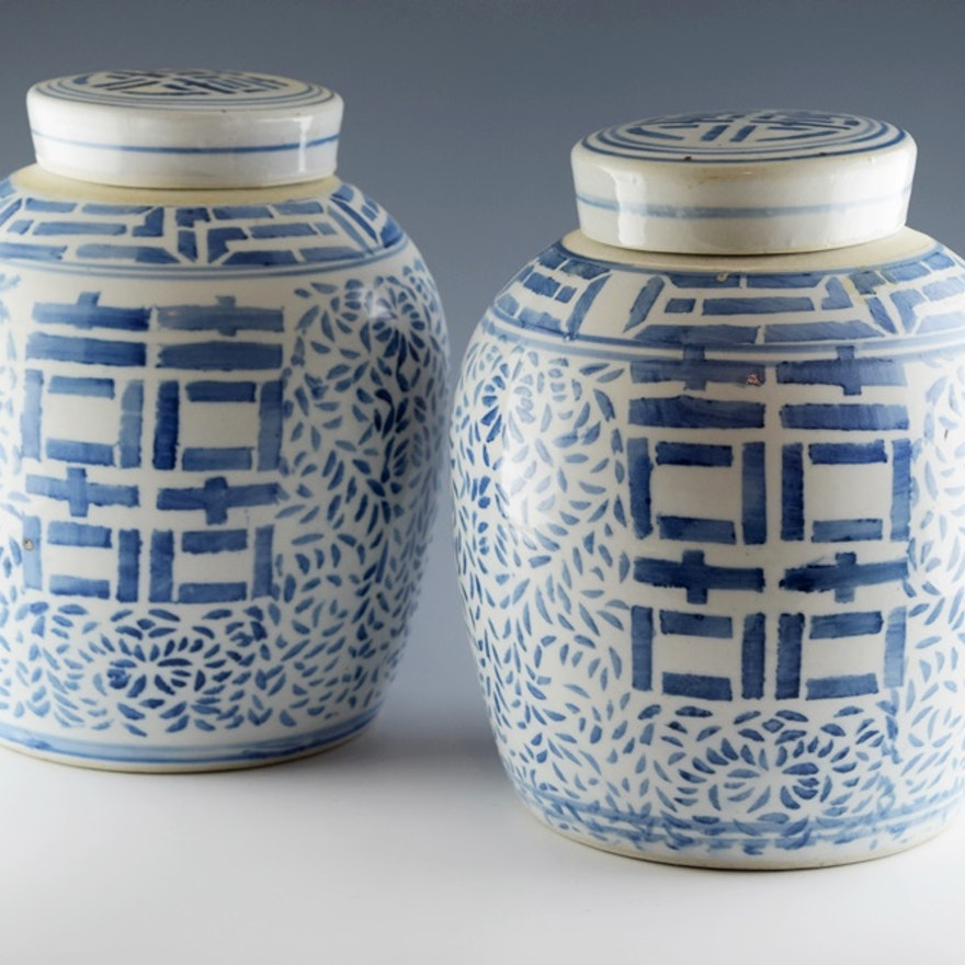 A Pair Of Chinese Blue And White Hiness Jars With Lids