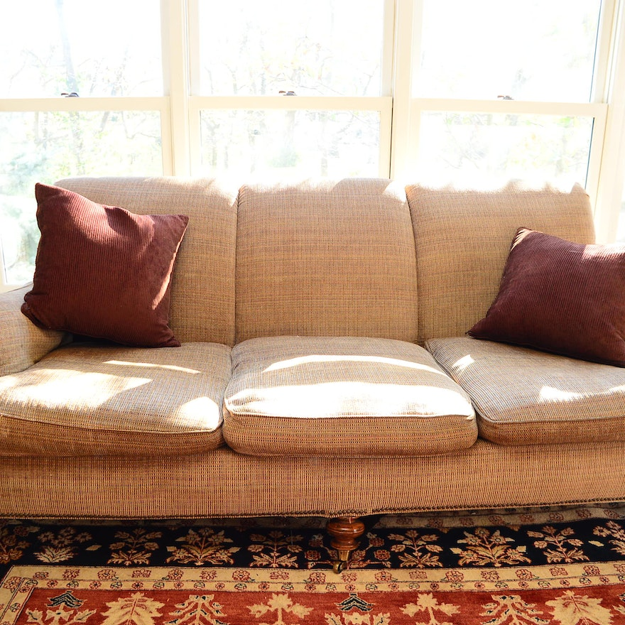 Caramel Sofa With Wood And Caster Legs Plush Pillows