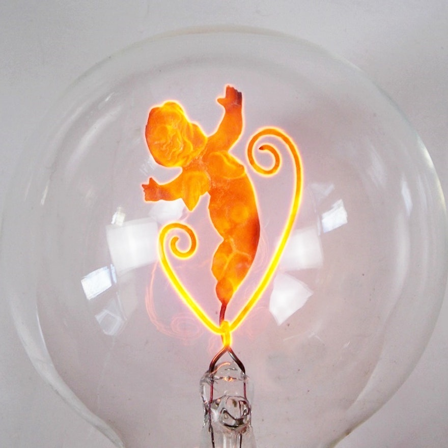Rare 1930's Aerolux Light Bulbs with Interior Figures That Glow