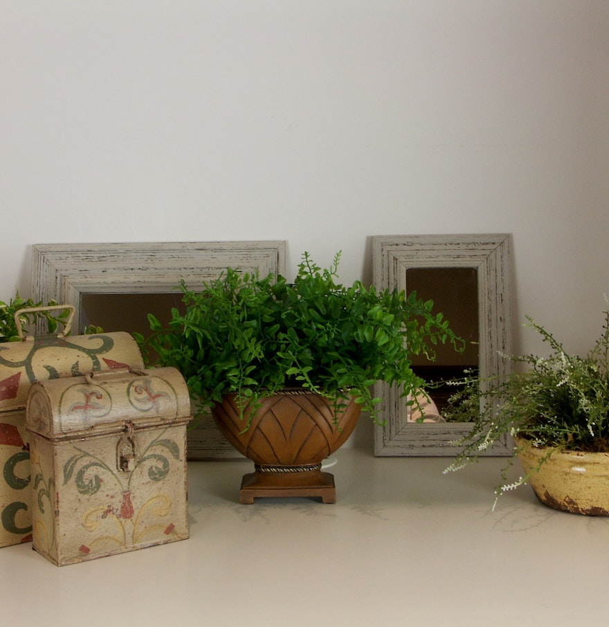 Decorative Mirror Groupings Decorative Grouping Of Mirrors Greenery And Metal Tins Ebth
