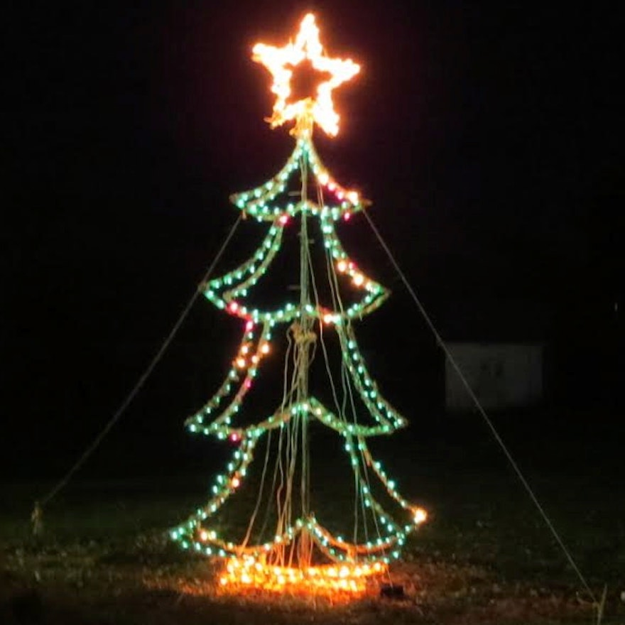 large outdoor lit wire frame christmas tree