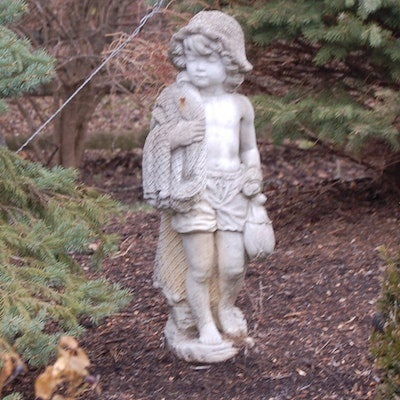 concrete garden statue of boy with fishing net - Concrete Garden Decor