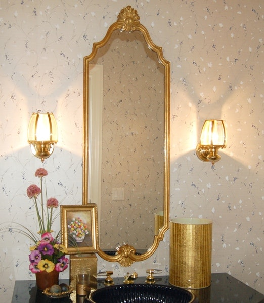 Ornate gold tone mirror and coordinating bathroom for Coordinating bathroom accessories
