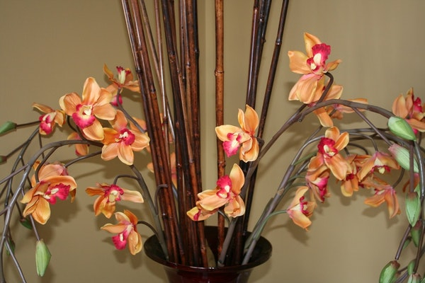 Large decorative vase with bamboo sticks and silk orchids