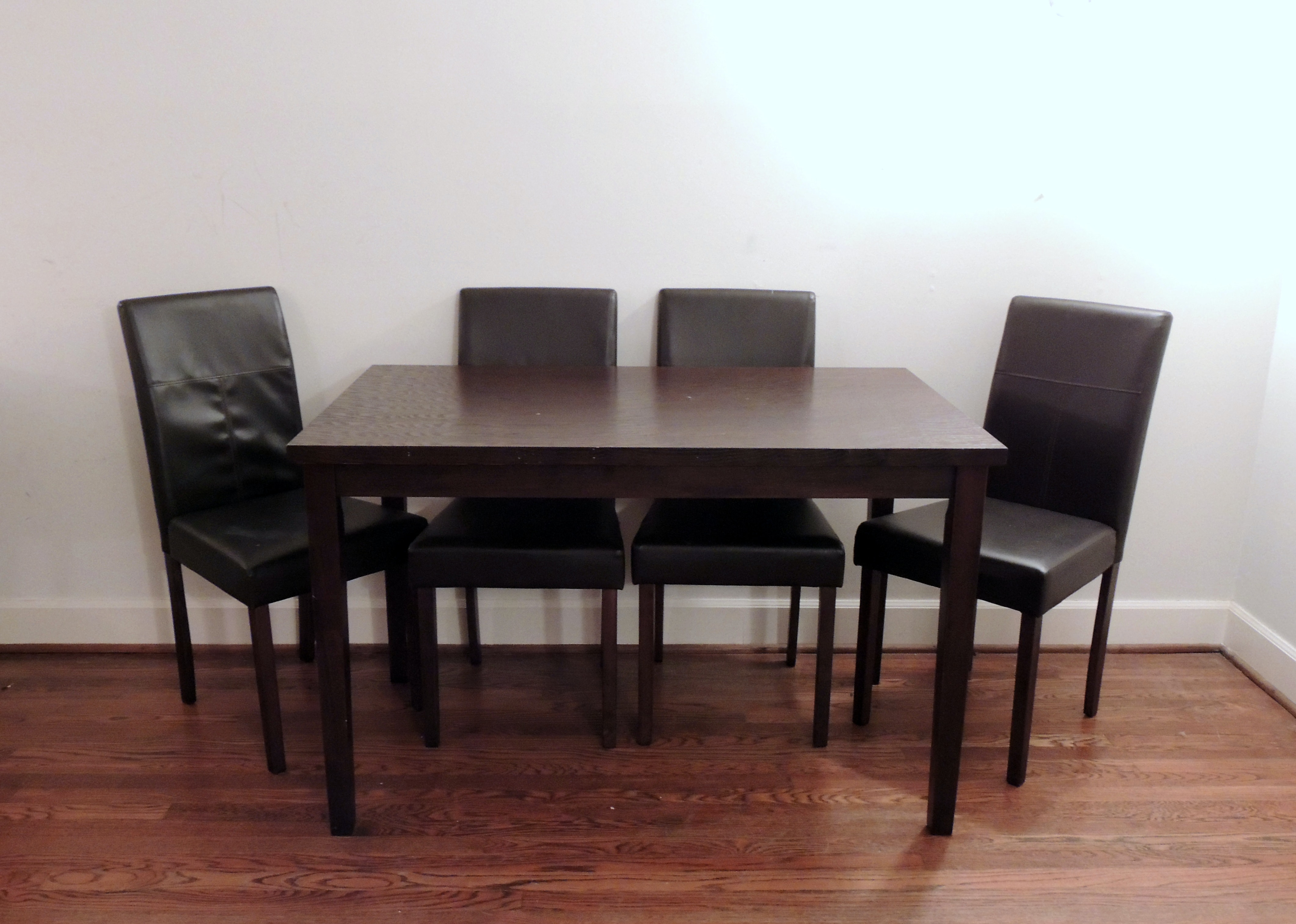 Dark Wood Table And Four Vinyl Parsons Chairs ...