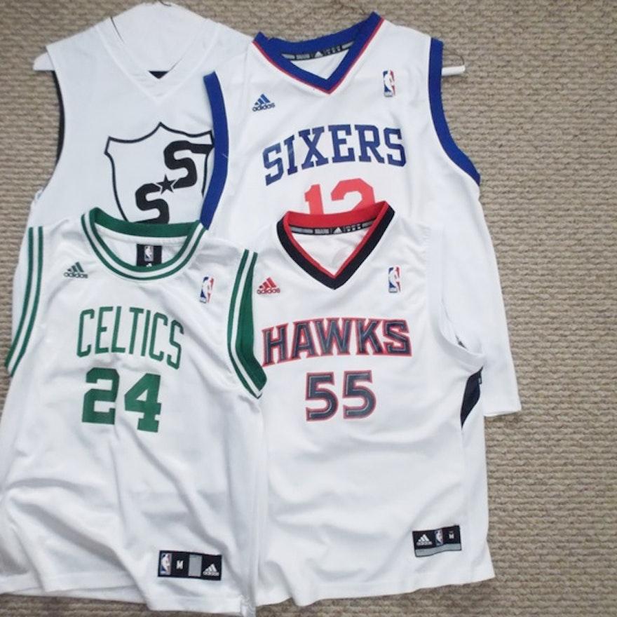 newest 222e3 c9998 Four Youth Size Custom Team Basketball Jerseys