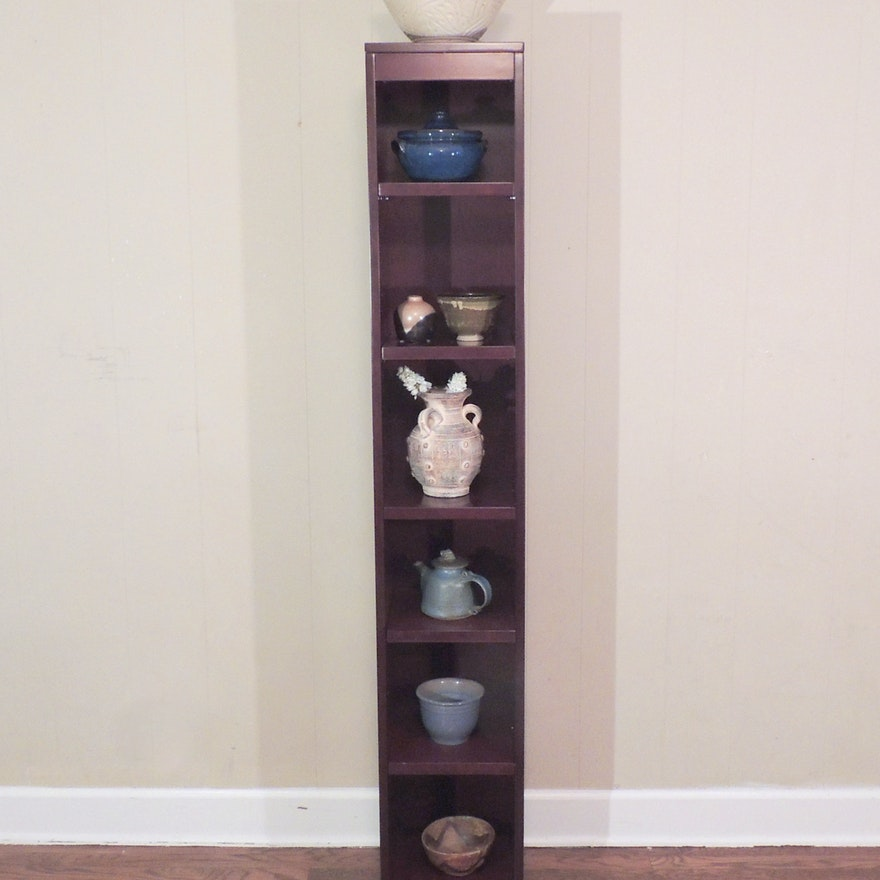 Tall Narrow Decorative Shelf With Eight Pottery Ceramic Pieces