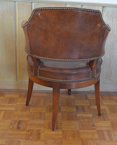 Brown Faux Leather Swivel Barrel Chair With Nailhead Trim