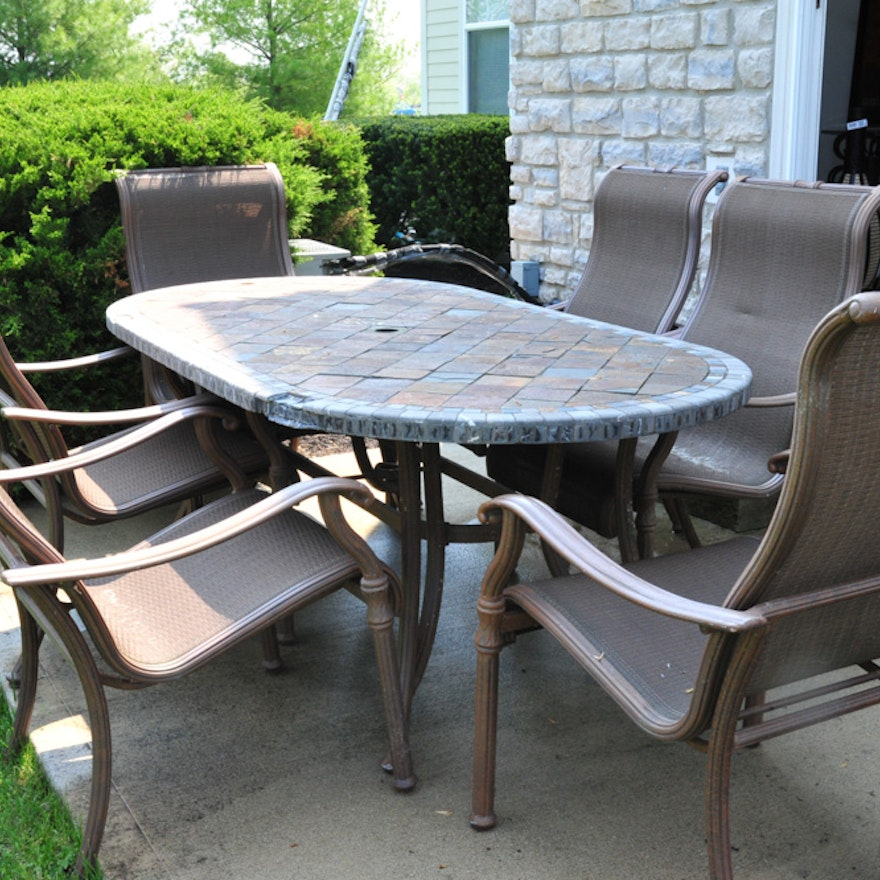 Oval Stone Top Patio Table And Six Chairs