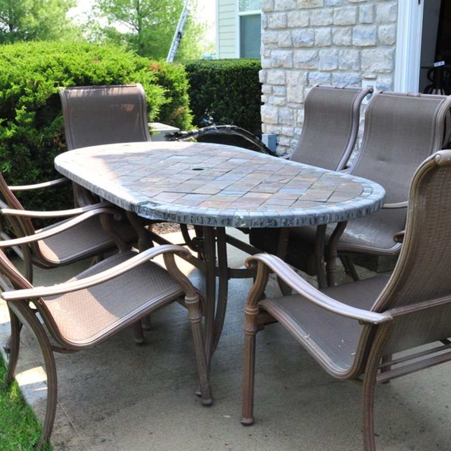 Oval Stone Top Patio Table And Six Chairs Ebth