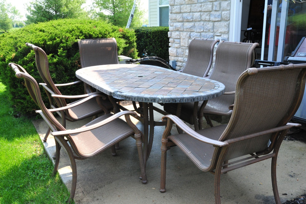 Oval Stone Top Patio Table And Six Chairs ...