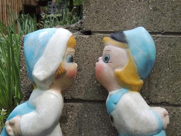 Dutch kissing boy and girl cement lawn ornaments ebth - Cement cloth garden ornaments ...