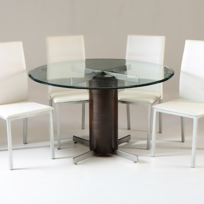 Glass Top Dining Table With Four White Chairs