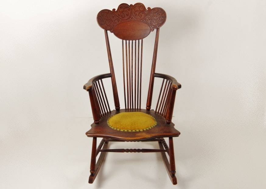 antique wooden rocking chair with padded seat