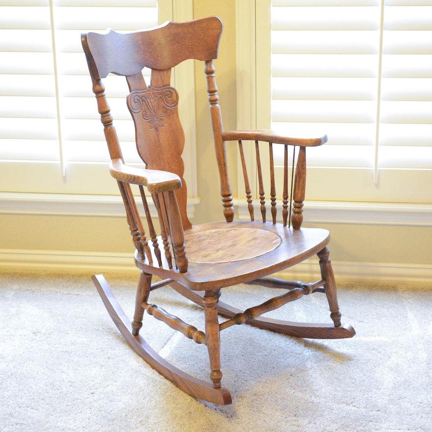 Antique Pressed Back Oak Rocking Chair