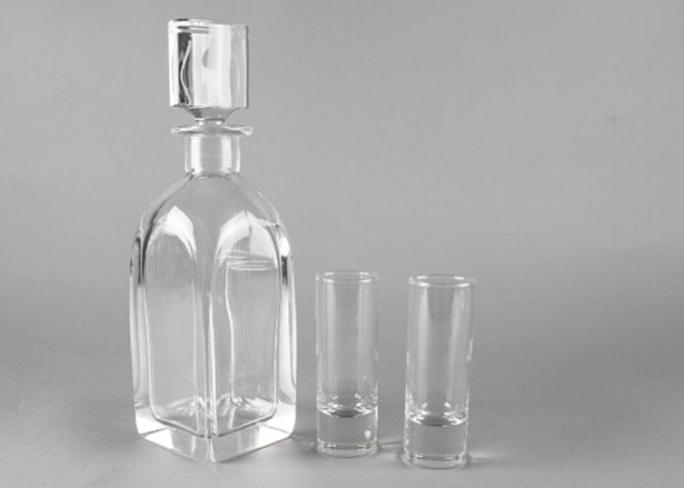 unusual lead crystal decanter and tall crystal shot glasses