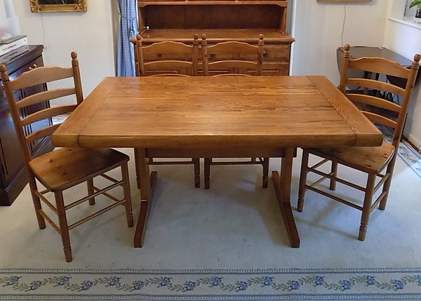 oak trestle dining table and four knotty pine chairs ebth