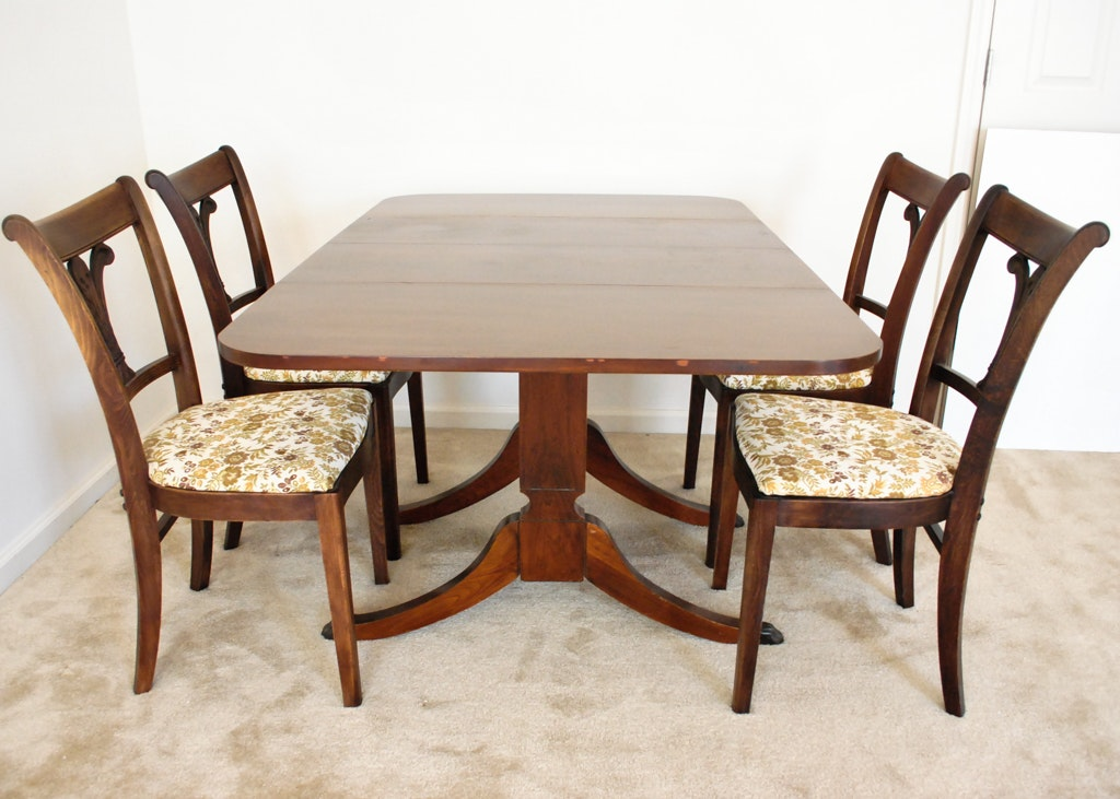 mahogany duncan phyfe style dining table and four chairs