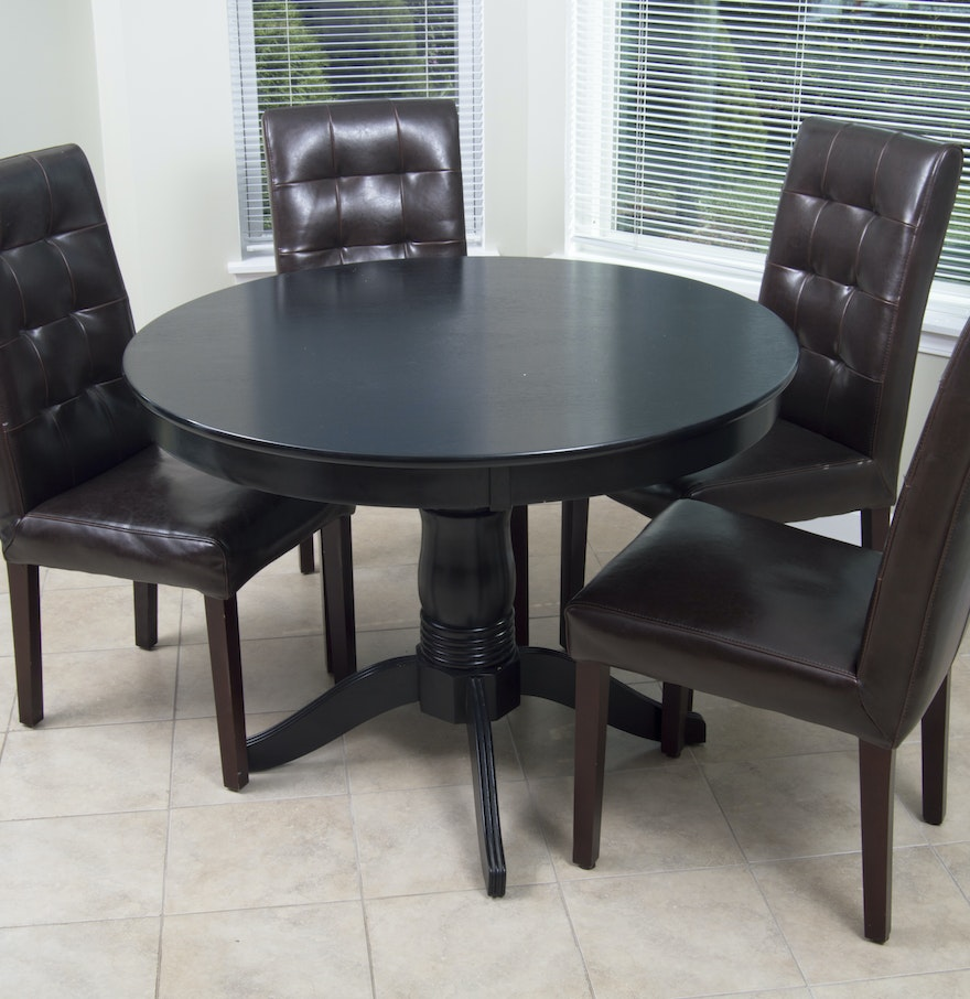 Round dining table with four tufted bicast leather parsons for Black leather parsons chairs