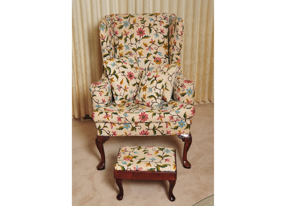 vintage wingback chair with stool