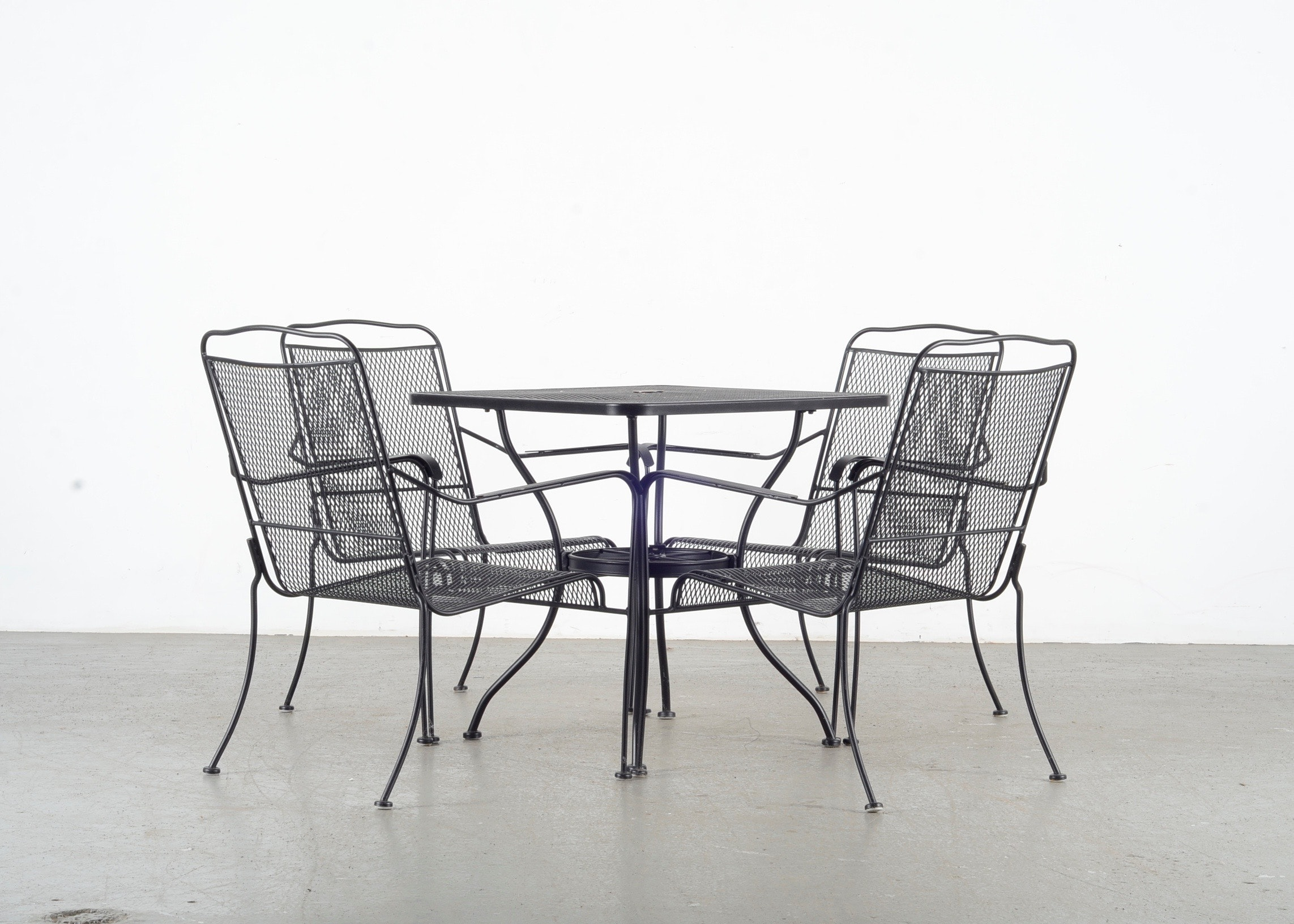 black metal patio table and four chairs ebth