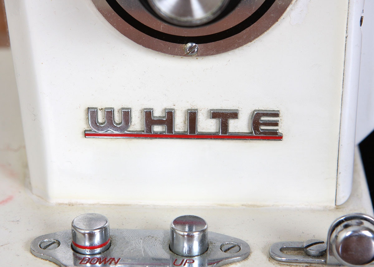 white brand sewing machine table