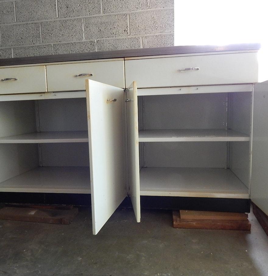 Vintage metal kitchen cabinet ebth for Antique metal kitchen cabinets